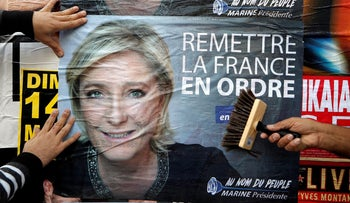 Le Pen supporters hang her poster in Antibes, France, last week