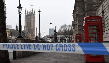 A police security cordon remains around the Houses of Parliament in London on March 23, 2017.