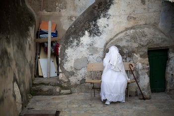 An Ethiopian Christian woman prays at Deir El Sultan outside the Church of the Holy Sepulchre, April 9, 2017.
