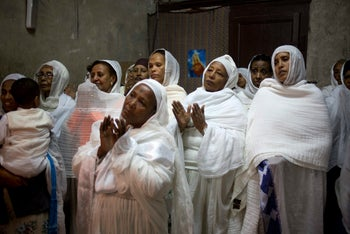 Ethiopian Christians pray at Deir El Sultan outside the Church of the Holy Sepulchre, Jerusalem. April 9, 2017.