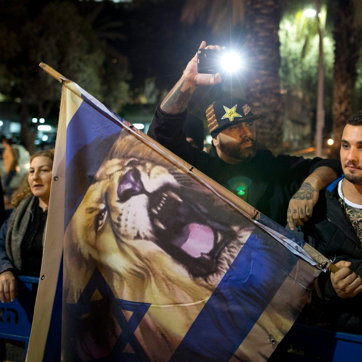 """Far-right activist Yoav Eliasi, aka """"The Shadow"""" (holding light), at a demonstration with supporters in Tel Aviv, December 2015."""