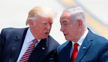 Prime Minister Benjamin Netanyahu, right, and U.S. President Donald Trump speak after Trump arrives at Ben-Gurion International Airport on May 22, 2017.