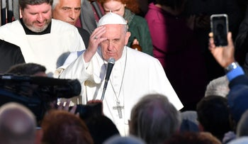 """Pope Francis leaves the Basilica of St. Bartholomew on Tiber Island after the Liturgy of the Word in memory of the """"New Martyrs"""" of the 20th and 21th century, on April 22, 2017 in Rome."""