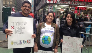 Rosmel Hernandez, an assistant researcher at the virology department of Mount Sinai hospital, protests with friends.