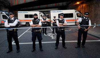 Police stand guard at a cordon on a road near Finsbury Park station after a vehicle struck pedestrians in north London, U.K., June 19, 2017.