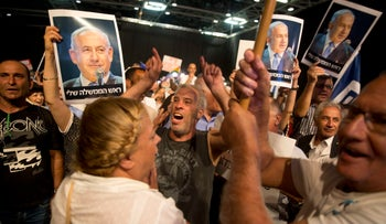 Supporters of Israel's Prime Minister Benjamin Netanyahu attend a Likud Party conference in Tel Aviv, Israel, Wednesday Aug. 9, 2017. At the conference Netanyahu lashed out at the media and his political opponents in an animated speech to hundreds of enthusiastic supporters on Wednesday, seeking to deliver a powerful show of force as he battles a slew of corruption allegations that have threatened to drive him from office.