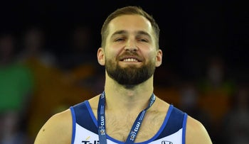 Bronze medal winner Alexander Shatilov of Israel during medal ceremony of men floor apparatus final for the European Artistic Gymnastics Championship in Cluj Napoca, Romania April 22, 2017.