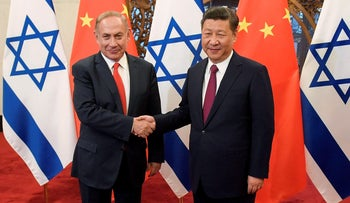 Israeli Prime Minister Benjamin Netanyahu and Chinese President Xi Jinping shake hands ahead of their talks at Diaoyutai State Guesthouse in Beijing, China March 21, 2017.