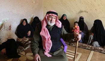 Palestinian refugee Abdullah Abu Massoud, 77, poses for a photo in his living room, in this photo taken Wednesday, Feb. 8, 2017.