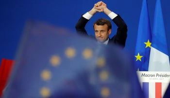 Emmanuel Macron celebrates on stage in Paris after the first round of the French presidential election, April 23, 2017.