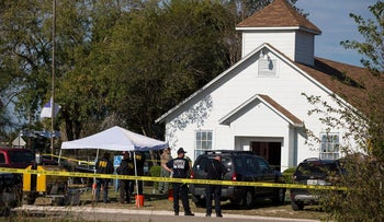 Law enforcement officials works at the scene of a fatal shooting at the First Baptist Church in Sutherland Springs, Texas, November 5, 2017.