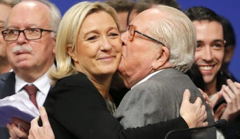 Marine Le Pen is kissed by her father Jean-Marie on November 30, 2014.