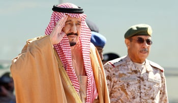 Saudi King Salman salutes as he attends a ceremony and air show in Saudi Arabia on January 25, 2017.