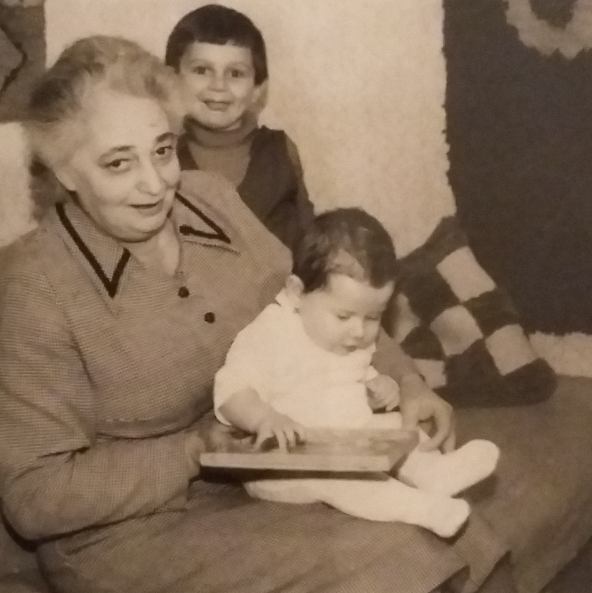 The woman from the photo in the 1970s with her grandchildren.