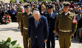 Israeli President Reuven Rivlin lays a wreath during a ceremony marking the annual Holocaust Remembrance Day at the Yad Vashem Holocaust memorial in Jerusalem, April 24, 2017.