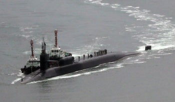Nuclear-powered submarine USS Michigan approaches at the southeastern port city of Busan on April 25, 2017.