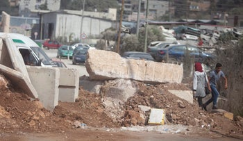 Concrete barriers blocking a road outside Huwara, West Bank, 2016.