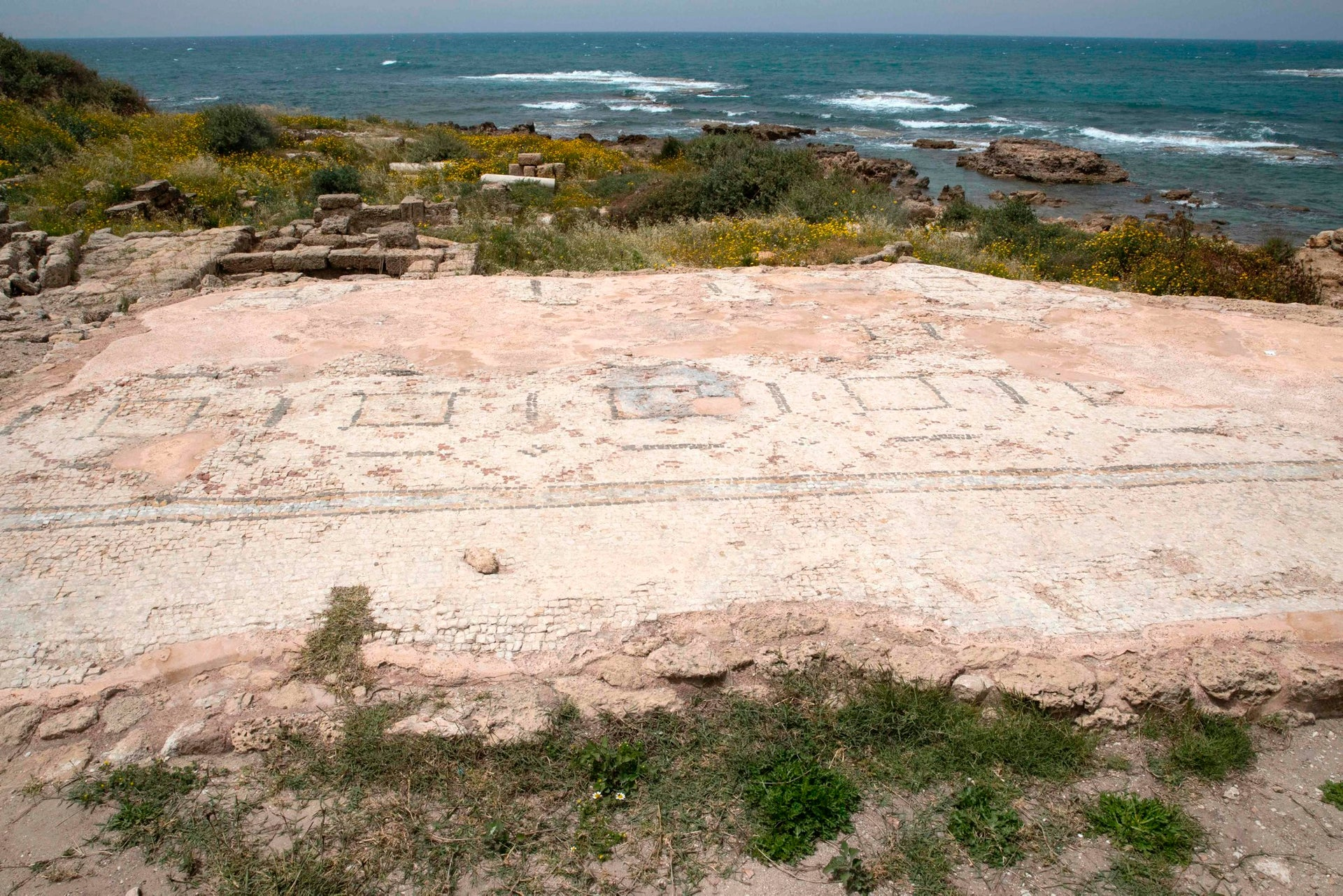 A picture taken on April 26, 2017, shows part of ancient synagogue, discovered during the renovation of the ancient harbour of Caesarea, being displayed during a press conference in the Israeli Mediterranean town of Caesarea.