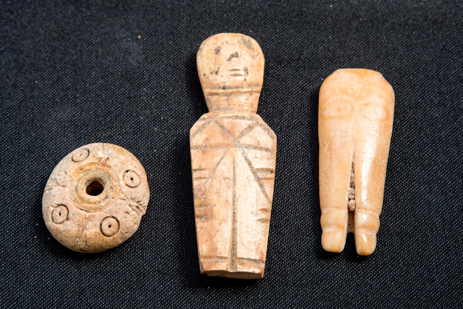 A picture taken on April 26, 2017, shows artifacts, discovered during the renovation of the ancient harbour of Caesarea, on display during a press conference in the Israeli Mediterranean town of Caesarea.