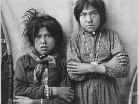 Two Tlingit girls, Tsacotna and Natsanitna, wearing nose-rings, near Copper River, Alaska, 1903: They seem to have descended from peoples who reached North America some 10,000 years ago, as the Tlingit oral tradition suggests.