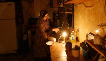 A woman working in her kitchen in Gaza's Shati refugee camp during a power outage, April  25, 2017.