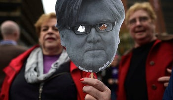 A demonstrator holds a paper cutout of Steve Bannon during a protest in response to President Donald Trump's refusal to make his tax returns public, Philadelphia. April 15, 2017.