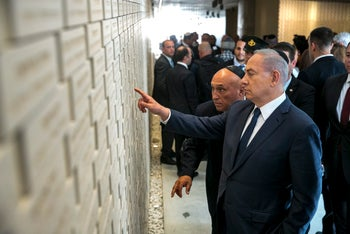 Benjamin Netanyahu points to the name of his brother, Yoni Netanyahu at a new section in the military cemetery at Mount Hertzl in Jerusalem ahead of the Memorial Day for the fallen Soldier, April 30, 2017.