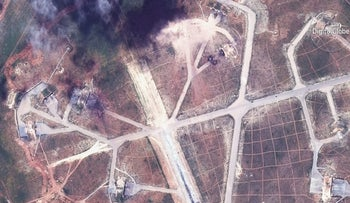 A satellite image from April 7, 2017, shows damage on the Shayrat air base in Syria following the U.S. Tomahawk missile strikes.