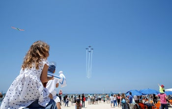 Israelis should go a bit more easy on the doom and gloom. Watching the Israeli Air Force Aerobatic Team aerial show on Independence Day in Tel Aviv. May 12, 2016.