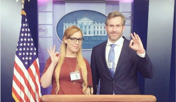Journalists Cassandra Fairbanks and Mike Cernovich pose in the White House briefing room, March, 2017.