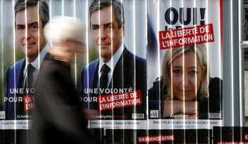 Campaign posters of Marine Le Pen of the National Front and Francois Fillon of the Republicans political party, in Paris, France, April 5, 2017.