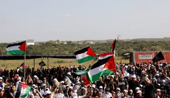 Israeli Arabs waving Palestinian flags during the annual march to commemorate the Nakba, May 2, 2017.