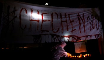 Activists from the group Chok3 paint a banner with their own blood during a protest against the constant discrimination and violence against the gay community in Chechnya and other regions of Russia, outside the Russian embassy in Mexico City, Mexico April 20, 2017.