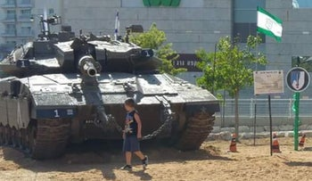 A tank behind the mall in Givatayim, in central Israel.