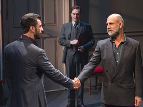 Michael Aronov, as Uri Savir, shakes hands with Anthony Azizi, as PLO Finance Minister Ahmed Qurie in the new Oslo dramatization.