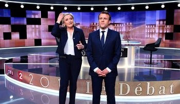 French presidential candidates Marine Le Pen and Emmanuel Macron pose prior to the start of a live televised debate on May 3, 2017.