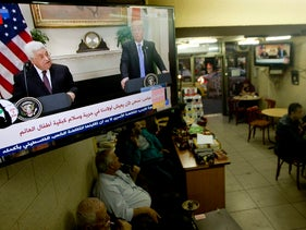 Palestinians at a Ramallah coffee shop as a television broadcasts the press conference between President Donald Trump with Palestinian President Mahmoud Abbas. May 3, 2017.