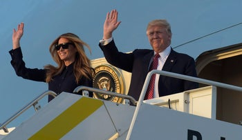 U.S. President Donald Trump and first lady Melania Trump wave from the top of the steps of Air Force One in Florida, February 10, 2017.