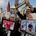 Protesters hold pictures during a rally supporting Palestinian prisoners in Israeli jails on a hunger strike, Ramallah, West Bank, May 3, 2017.