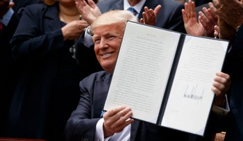 "US President Donald Trump showing the ""Executive Order on Promoting Free Speech and Religious Liberty"" in the Rose Garden of the White House, May 4, 2017."