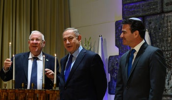 Mossad head Yossi Cohen, Prime Minister Benjamin Netanyahu and President Reuven Rivlin, at a Hanukkah ceremony in 2016. Cohen is considered a confidant of the PM