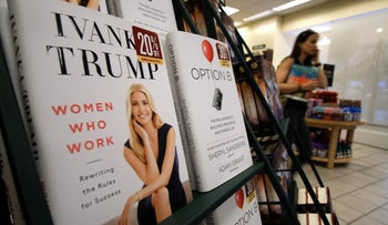 A woman walks past a shelf displaying Ivanka Trump's book 'Women Who Work: Rewriting the Rules for Success' at a Barnes and Nobel bookstore in New York on May 2, 2017.