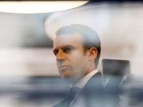 Emmanuel Macron, head of the political movement En Marche! and candidate for the presidential election, is seen through a window of his hotel during a campaign visit in Rodez, France, May 5, 2017.