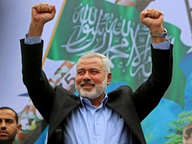 FILE PHOTO: Palestinian top Hamas leader Ismail Haniyeh greets supporters during a rally to commemorate the 27th anniversary of the Hamas militant group. Gaza, Dec. 12, 2014.