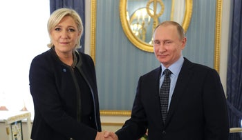 Russian President Vladimir Putin shakes hands with Marine Le Pen, candidate for the French 2017 presidential election, during their meeting in Moscow, Russia March 24, 2017.