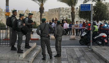 Israeli border guards secure the scene of a reported stabbing attack carried out by a Palestinian woman at Damascus Gate in Jerusalem's Old City, May 7, 2017.