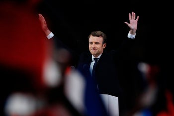 French president-elect Emmanuel Macron waves to the crowd as he delivers a speech at the Pyramid at the Louvre Museum in Paris on May 7, 2017, after the second round of the French presidential election.