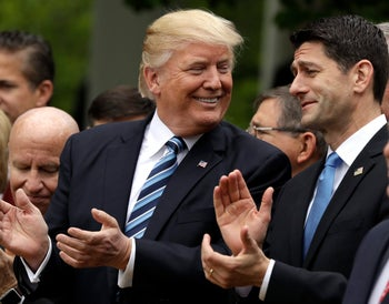 In this May 4, 2017, photo, President Donald Trump talks to House Speaker Paul Ryan of Wis. in the Rose Garden of the White House in Washington, after the House pushed through a health care bill.