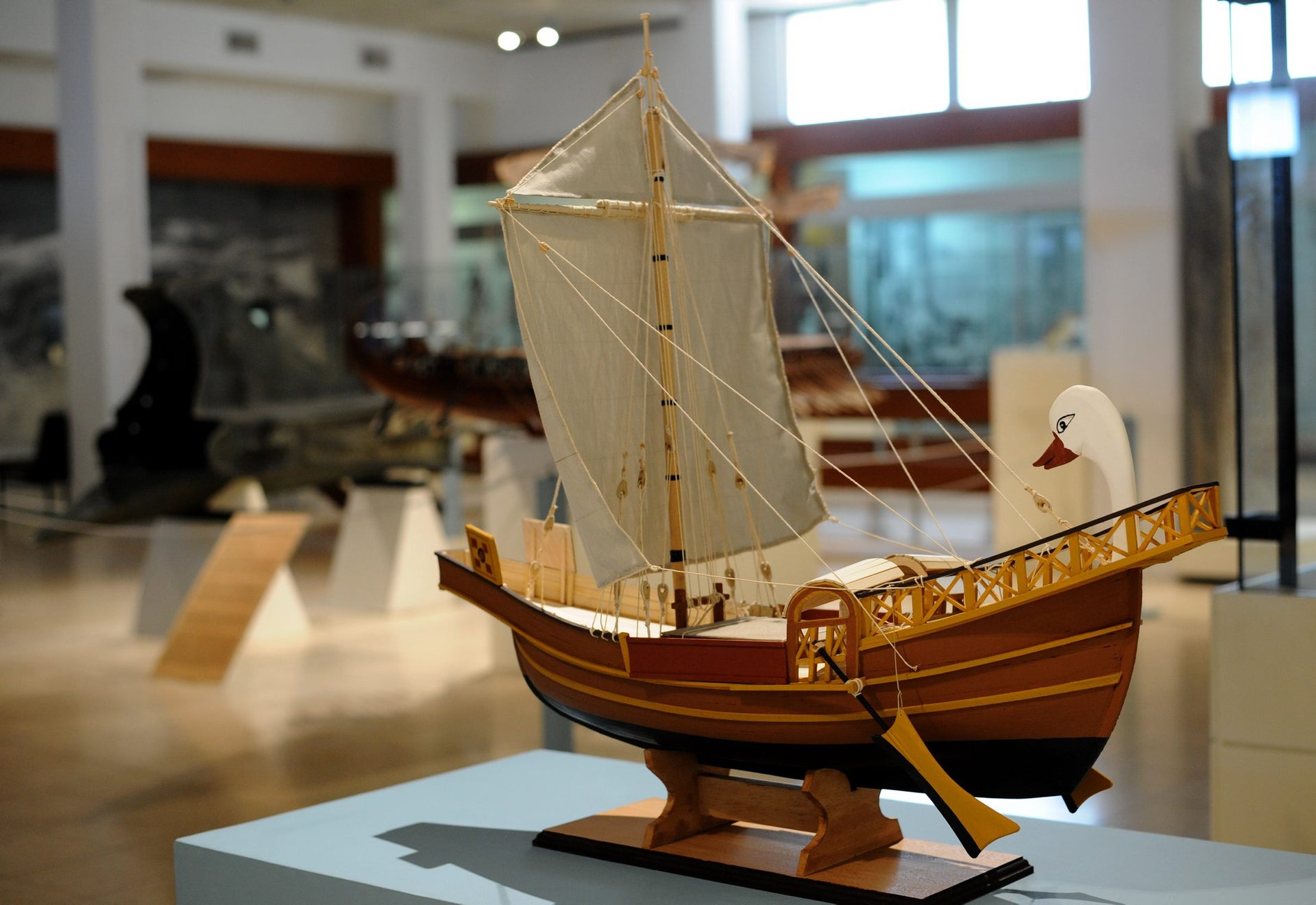 A precise wooden model of the ship in the mosaic.