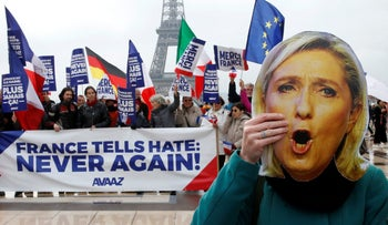 A mask of France's defeated National Front candidate, Marine Le Pen, at the Eiffel Tower the day after the elections. May 8, 2017.